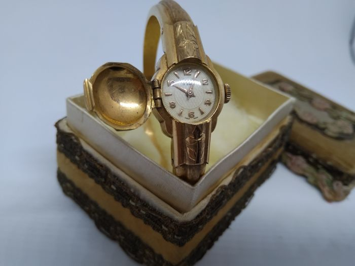 Gold watch from the 1930s, with rigid gold manacle-style bracelet strap, with 750 gold hallmark - make: TELL Swiss made, 17 rubies.