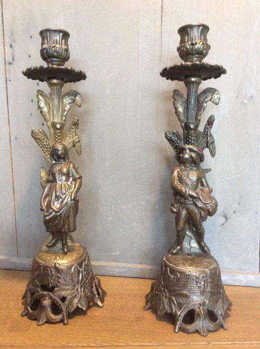Pair of candlesticks in bronze or brass, 19th or early 20th century. Registered model