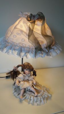 Table lamp with a porcelain doll