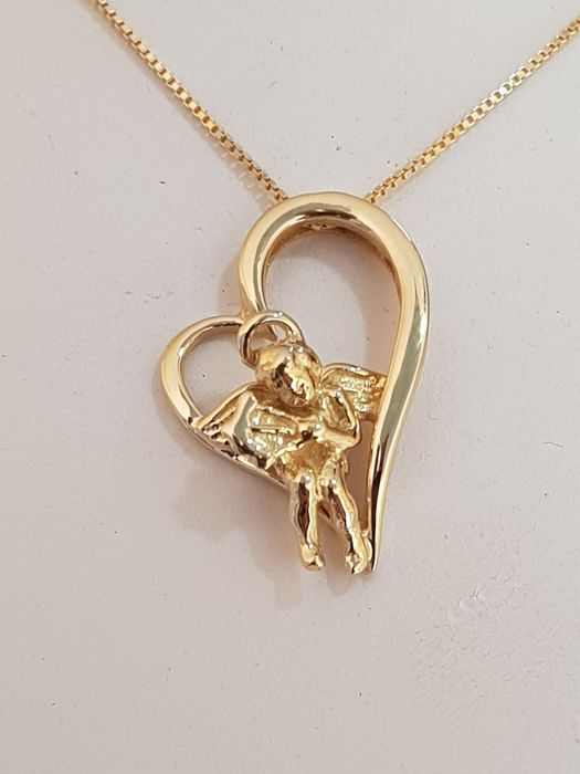 'Angelo e Cuore' (Cupid and Heart) pendant and chain, in 18 kt/750 yellow gold