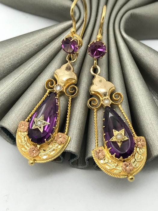 Amethyst hanging earrings in oriental design with freshwater pearl accents, 14 kt gold