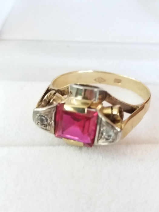 Rare Vintage design step cut  Red Tourmaline and old round cut white Sapphire on accents in yellow gold ring.