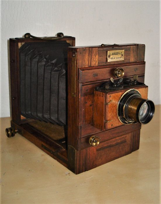 Antique small plate bellows camera, wooden travel camera with optics