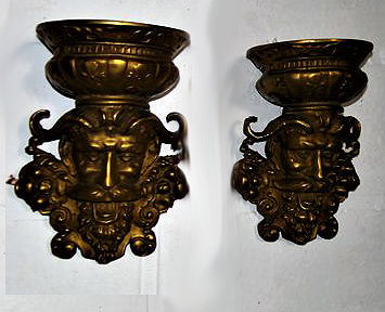 Two bronze wall lamps with devil's head, France, ca. 1950