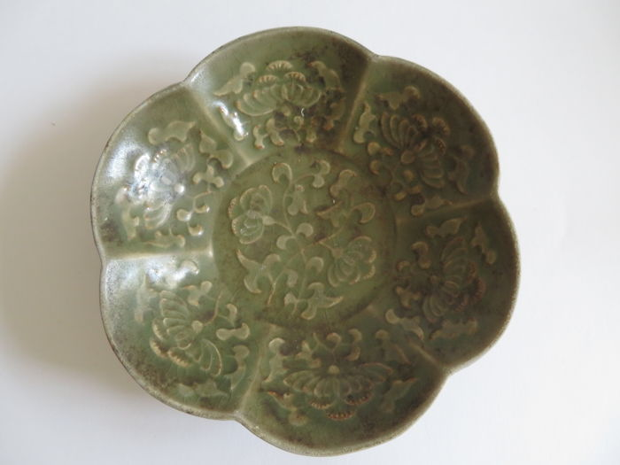 A deep green colour Chinese celadon bowl with very rich moulded flowers and birds decoration -  146 mm