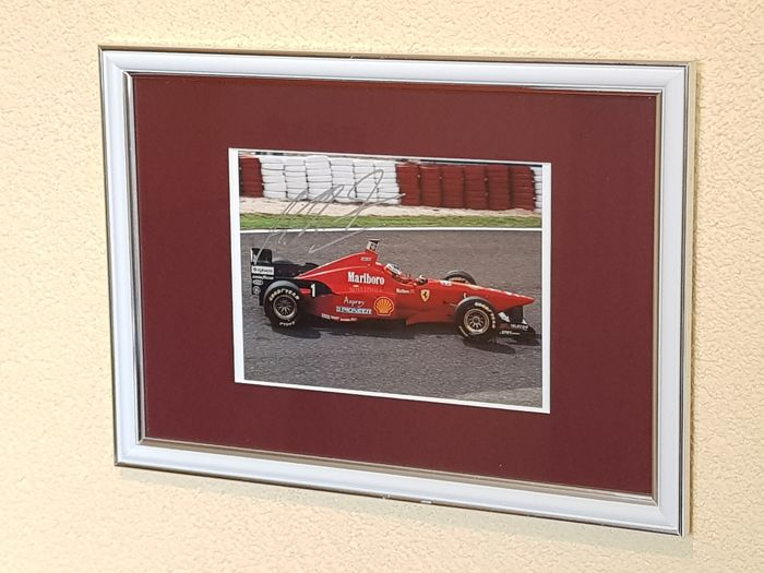 Michael Schumacher - Rare photo in Ferrari - Fantastic framed hand signed + COA.