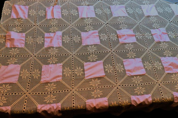 Crochet tablecloth in cream with pink fabric