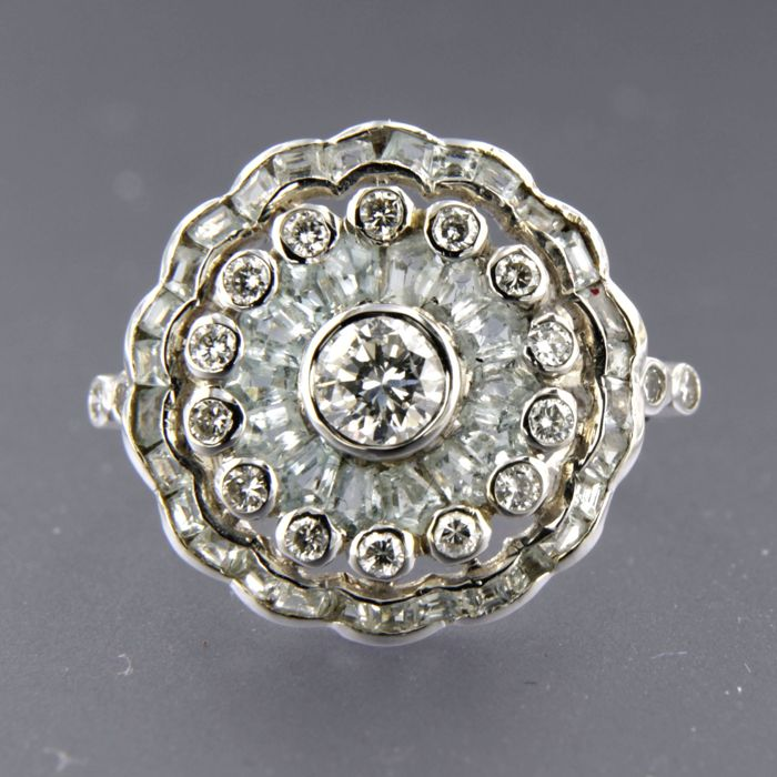 - no reserve price - 14 kt white gold ring set with blue topaz and 19 brilliant cut diamonds of approx. 0.65 ct in total