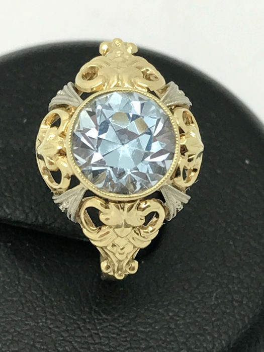 Aquamarine solitaire ring round approx. 1.5 ct in 14 kt / 585 yellow & white gold floral design