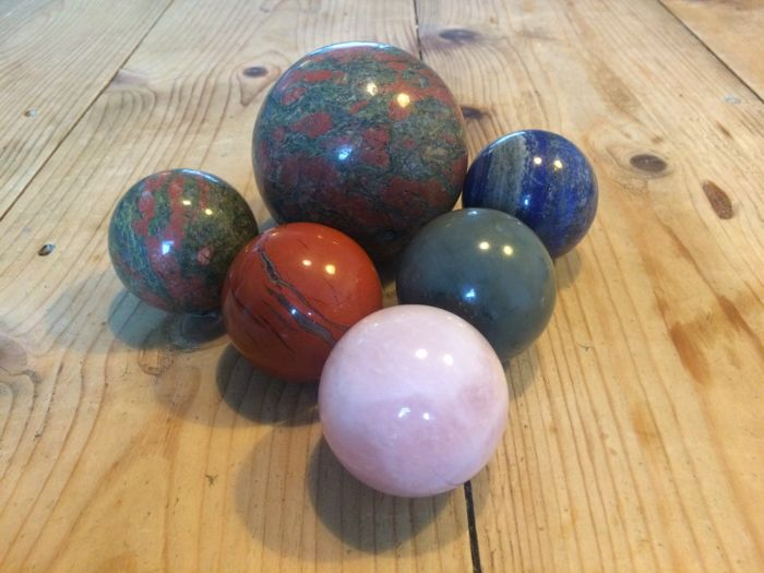 A collection of mineral spheres - 5 to 8.1 cm - 1716 gm (6)