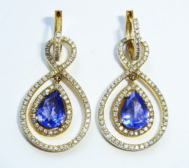 2-in-1 golden drop earrings with 2,35 ct tanzanites and 0,92 ct diamonds