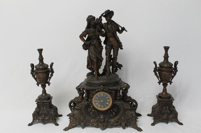 Large spelter clock with candelabra,   Napoleon III period and signed S.MARTI