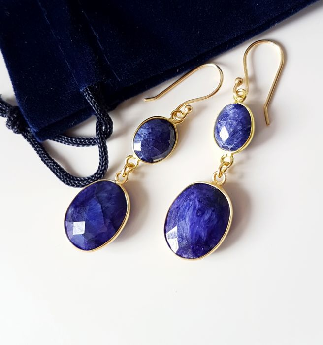 18K gold earrings, inlaid with facetes demi-clear sapphires, handiwork.