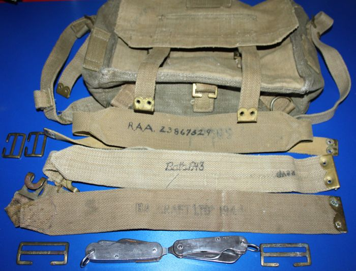 Lot of 2 British post world War II Army Clasp knives items marked with Broad Arrow, maker's mark and dated ,1953/55, some WW II webbing and a bag