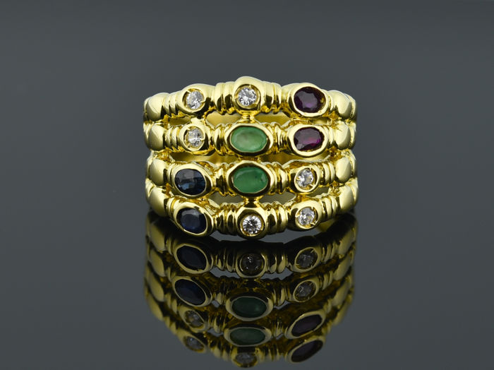 18 kt gold. Ring with sapphires, emeralds, rubies and topazes  Size: 56 (diameter 17.7 mm)