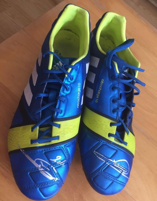 Adidas Nitrocharge 1.0 boots signed by Zinedine Zidane with a photo of the moment