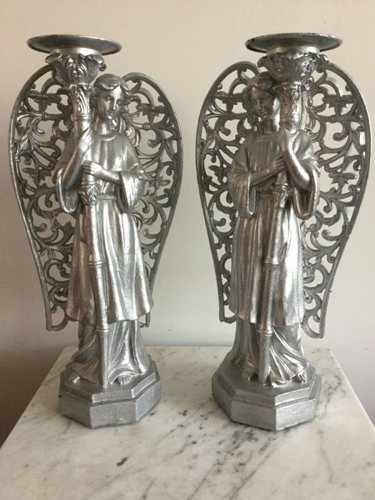 Pair of large silver candlesticks with Madonna angels