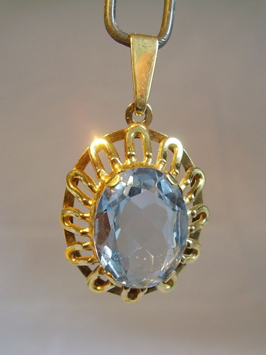 Golden pendant with large oval faceted synthetic aquamarine of 16 golden pendant with large oval faceted synthetic aquamarine of 16 ct aloadofball Images