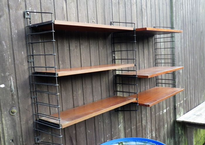 A. Dekker for Tomado - book/wall rack with original wooden shelves and 3 writing top's in teak