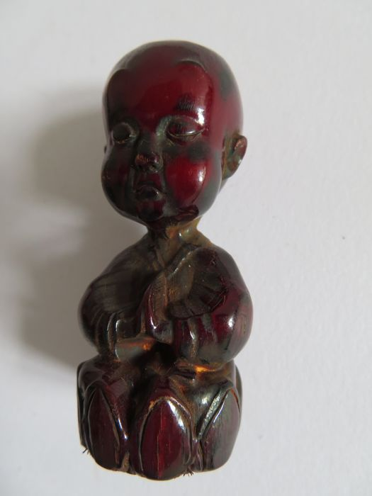 An exceptional wild mountain bufffalo's horn talisman in form of sitting Child Buddha on lotus  - 61 x 26  mm