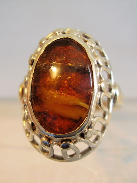 Antique natural amber ring with inclusions