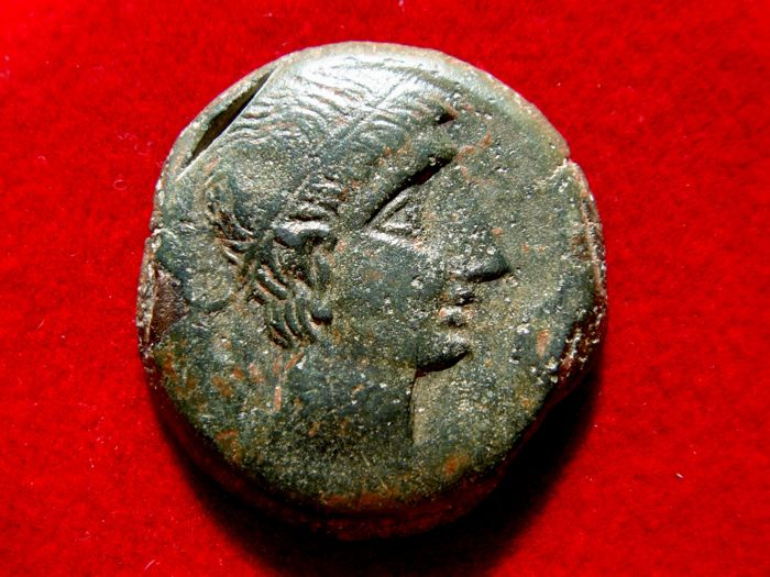 Roman Hispania - Castulo (Linares, Jaen), bronze as (14.30 g 25 mm.) struck between the years 180 – 150 B C Sphinx and legend 'Castele' in Iberian lettering below