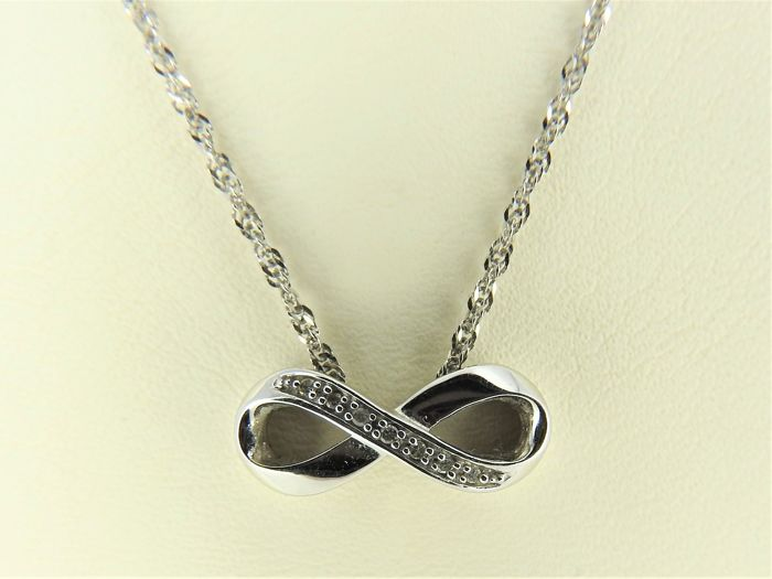 14 kt white gold necklace and infinity pendant set with diamond of 14 kt white gold necklace and infinity pendant set with diamond of approx aloadofball Images