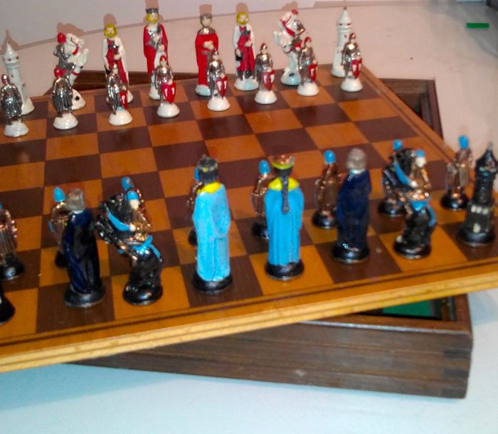 Metal chessboard with hand-painted pieces, made by the San Patrignano youth