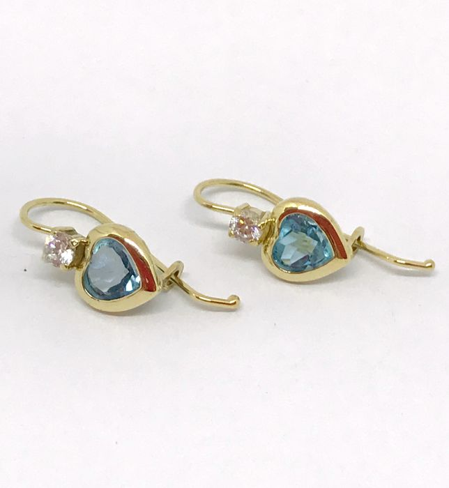 18 Kt Yellow Gold Heart Shaped Earrings With Zircons And Light Blue Stone,  Weight