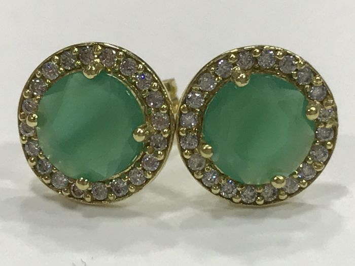 Earrings in 18 kt gold with emerald