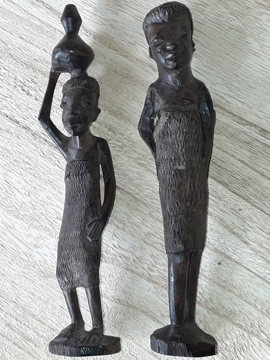 Beautiful old wooden sculptures: male and female, antique dark wooden sculptures, 19th late century period ,very finely carved ,very special decoration.