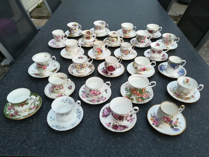 54-piece English porcelain cups and saucers including Royal Albert, Elizabethan, Queen's