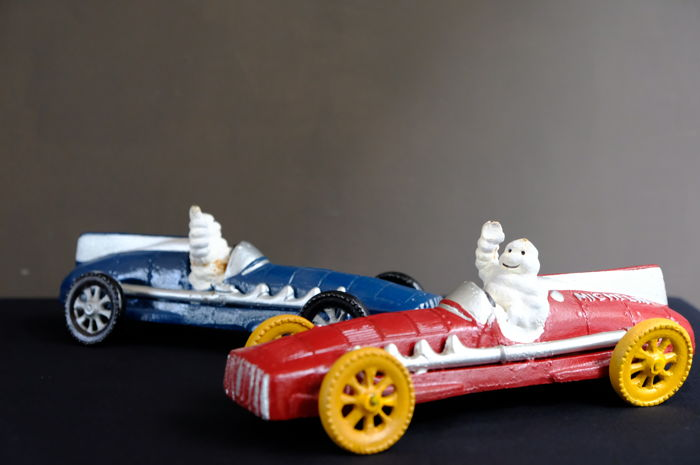 Michelin Man Bibendum Riding in a Blue and Red Racing car   -   Iron -   Made in England