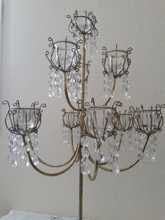 Girandole candelabra with 10 branches made of gilded bronze and glass or crystal tassels