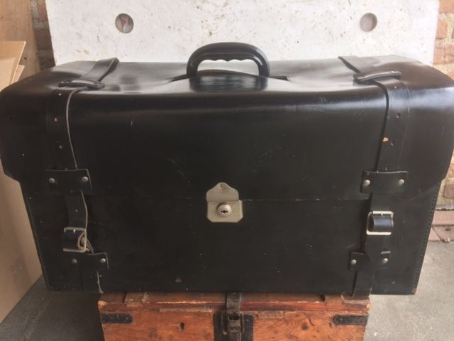 Original heavy leather tool case for a classic car containing an original Caltex oil can 2 litres