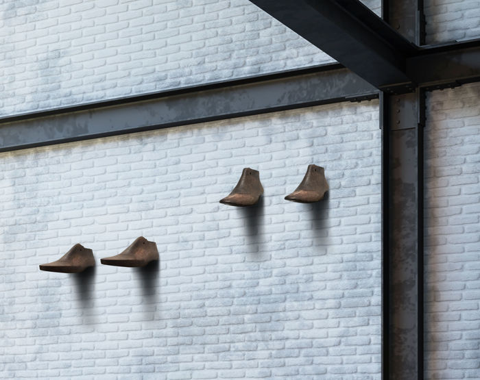 Art installation - Wooden shoe models to use also as a coat hanger