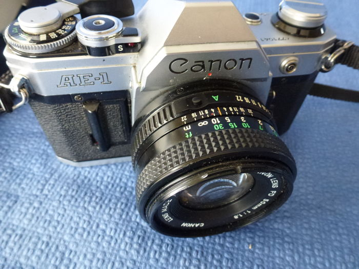 Analogue camera Canon AE-1 + Flash with set of filters