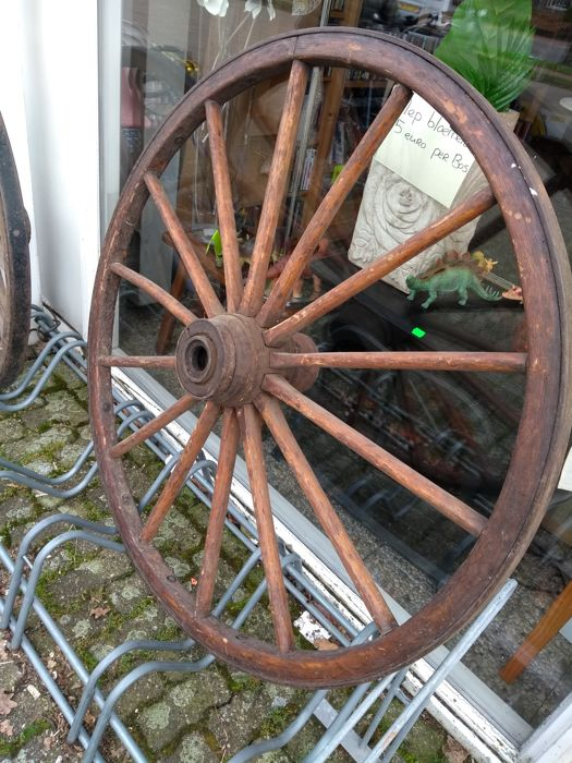 A wooden wheel of tool with iron band
