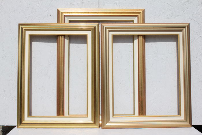 Three wooden picture frames with inlay