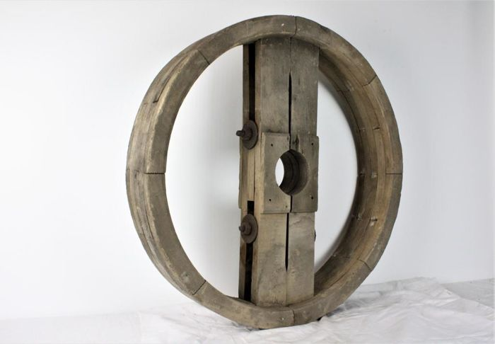 A wooden mould - that was used to make cast iron wheels, from the early 20th century