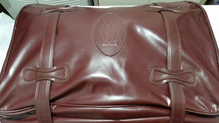 Authentic Cartier suitcase in maroon leather