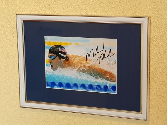 Michael Phelps - Greatest Olympic athlete of all time - hand signed framed photo + COA.