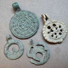 Early Medieval bronze pendants decorated 23х19, 25х20, 30х22, 35х27 mm