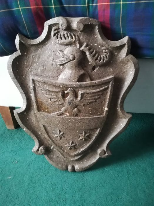 Hand carved coat of arms