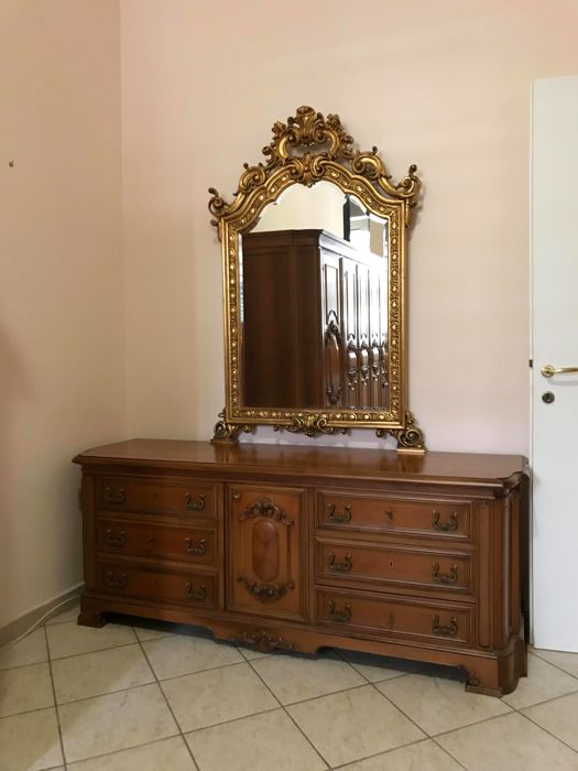 Bedroom: made in national walnut wood by the Permanente Mobili in Cantù, consisting of wardrobe, dresser with mirror, bed and 2 night tables Italy, second half of the 20th century