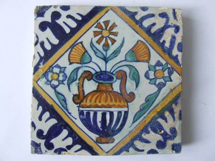 Coloured square tile with a flower vase, central Netherlands, first half of the 17th century
