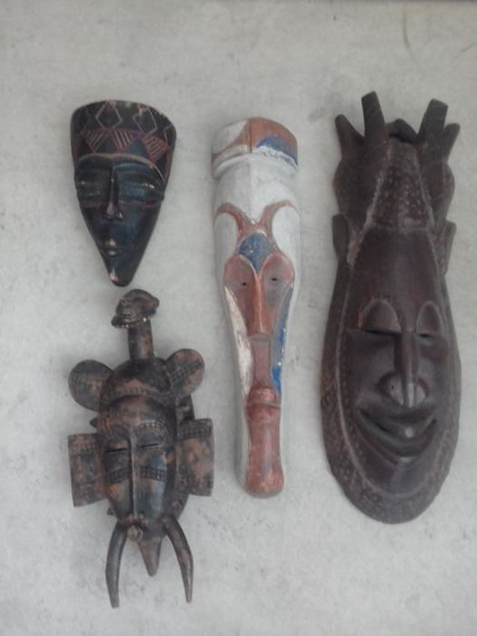 Vintage African hand crafted wooden decorative masks x 4