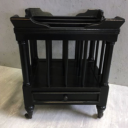 A black Canterbury / Magazine rack, England, second half of the 20th century