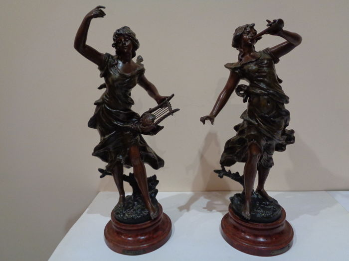 Pair of sculptures in babbitt metal/zamak with patina in bronze titled 'Melodie' and 'Flûte enchantée' on wooden base - signed Ruffony - France - early 20th century