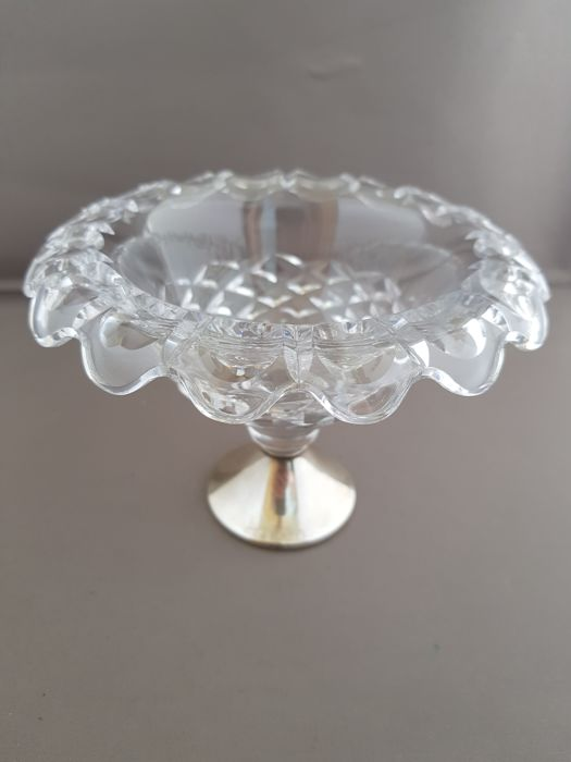 Glass bowl with a silver base
